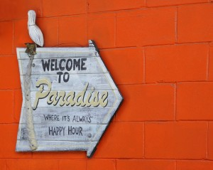Welcome to Paradise sign at Crab Shack
